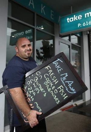 Forde business owner Pat Di Placido from Take Me Away takeaway setting up for another nights trade.