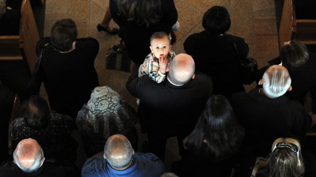 A child is the only one who spots <i>Age</i> photographer Mal Fairclough up above during the Easter Service at Our Lady ...