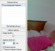 An image uploaded to a hacking forum showing a woman sleeping as seen through her webcam.