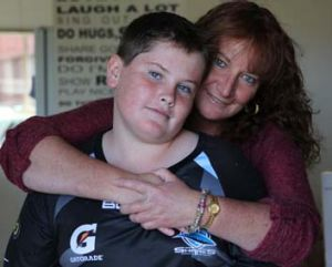Saving grace: Single mother Justine Proctor with her 12-year-old son Luke.