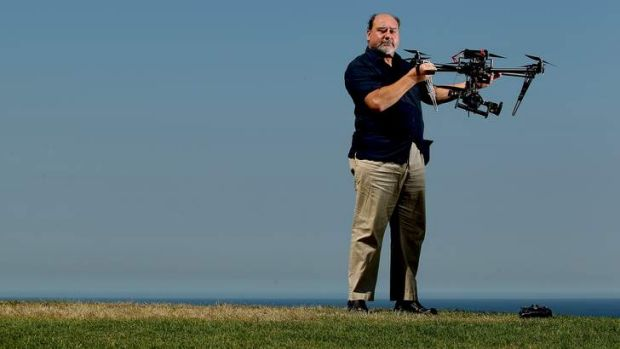 SMH  -  Mark Pearson who is head of Animal Liberation Society NSW wit a helicopter drone they have purchased to fly over ...