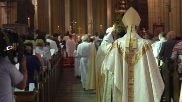 Anglican Archbishop of Brisbane Phillip Aspinall leads the Easter Sunday procession at St John's Cathedral. Photo: ...