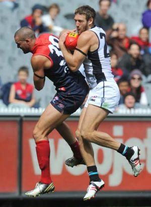 Demon James Sellar goes up but Port's Jay Schulz ends up getting the ball.