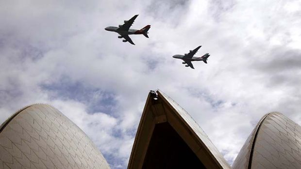 Off-stage: Qantas and Emirates planes launch the alliance over the Sydney Opera House.