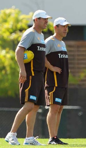 Hawthorn's assistant coach Brett Ratten and coach Alastair Clarkson look on during a training session at Waverley Park ...