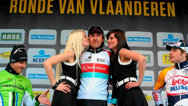 Caught in the act ... Peter Sagan on the podum as race winner Fabian Cancellara is kissed.