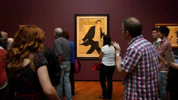 Visitors to the National Gallery of Australia look at the work Caudieux during Toulouse Lautrec exhibition.