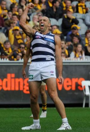 Geelong's James Podsiadly celebrates a goal against Hawthorn on Easter Monday.