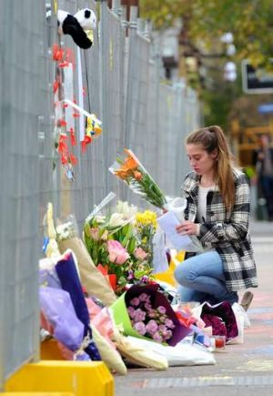 Tributes have been made to those killed in the wall collapse on Swanston street.