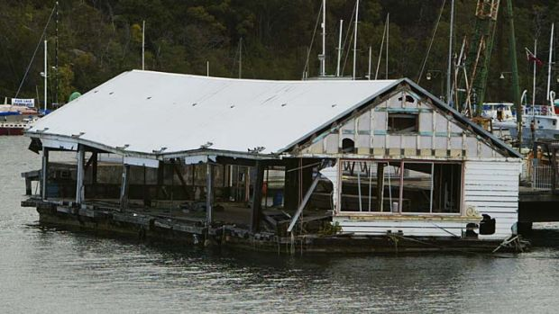Vision versus reality: The old barge at Berrys Bay in 2000, was once used as a floating dance hall.