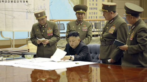 Kim Jong-un discusses the strike plan with North Korean officers.
