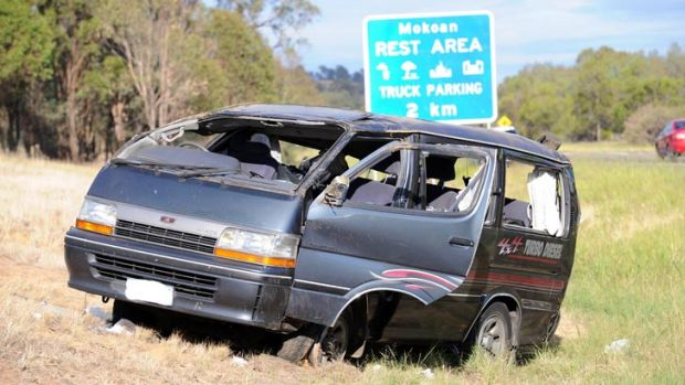 The damaged van on the side of the Hume Freeway.