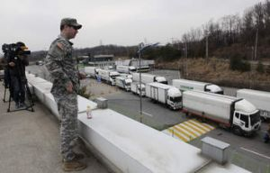Watchful eye: South Korean vehicles return from Kaesong, banking up at the customs, immigration and quarantine office.