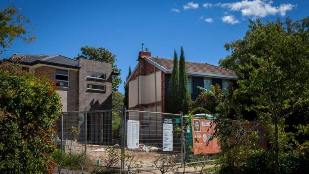 Owner of one half of a classic Canberra duplex is angry about their neighbour demolishing the other half in Fraser ...