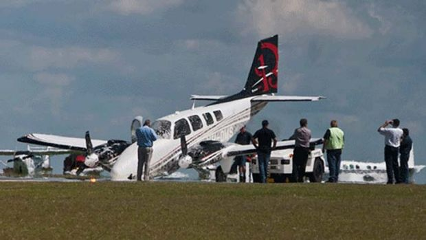 Two people on board this plane escaped without injury when its nose gear failed while landing at the Toowoomba Airport.