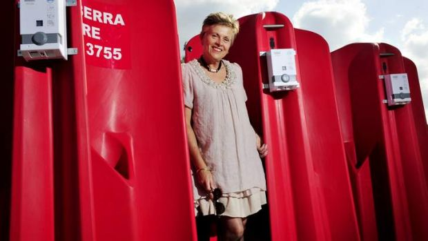 CEO of Canberra CBD limited Jane Easthope with the outdoor urinals.