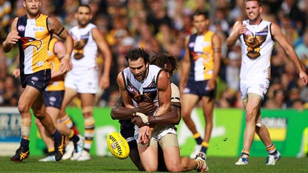 'House of Pain': Jordan Lewis is tackled by Nic Naitanui during the Hawks' loss to West Coast in round four last year.