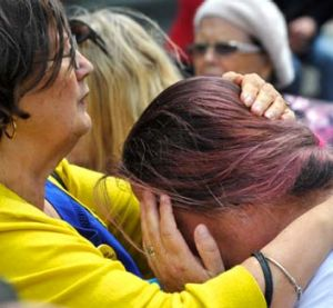Emotional: Leonie Sheedy, left, from The Care Leavers Australia Network comforts a former Ward of the State.