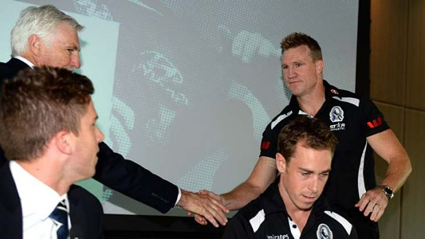 Carlton coach Mick Malthouse and Collingwood captain Nick Maxwell at the Peter Mac breakfast at the MCG.