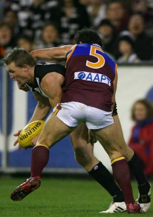 Nathan Buckley and Brad Scott tangle during their playing days.