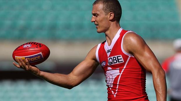 Keeping it in the family: Ted Richards celebrates his 150th game, against the Gold Coast Suns at the SCG on Saturday.