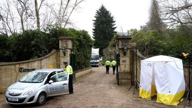 Police outside the gates of Boris Berezovsky's mansion in Sunningdale near Ascot after his death last month.