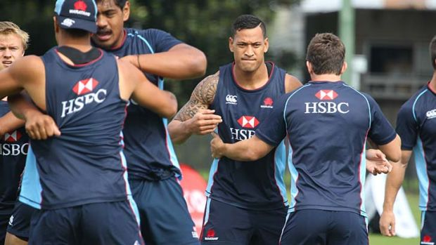 Potential: Israel Folau (second from right) trains with the Waratahs at Moore Park, leading up to their match against ...