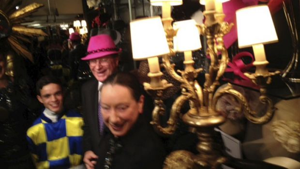 Apprentice jockey Chris Caserta, Premier Denis Napthine in a hot pink trilby by milliner Philip Treacy and Christine ...