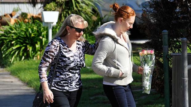In mourning: Mikayla Bishop and her mother Sandra, a former teacher, arrive at Montmercy Secondary College yesterday.