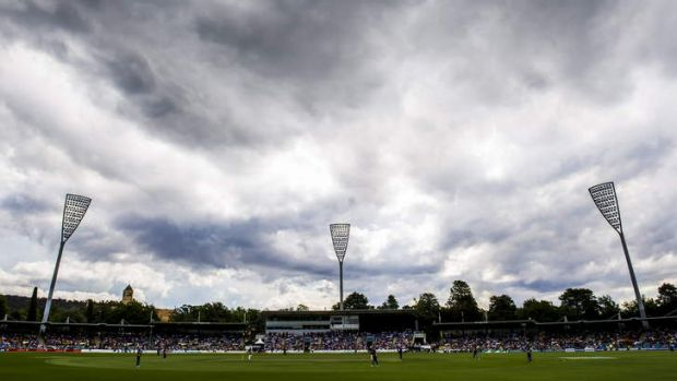 Dark clouds pass over the Manuka oval during the PM's XI match in January.