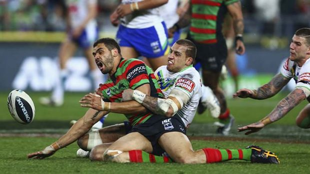 Armless: The Rabbitohs' Greg Inglis is tackled by the Raiders' Blake Ferguson.