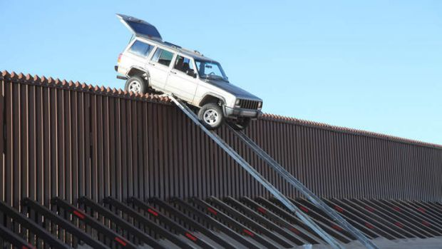 This vehicle became stuck on top of the US-Mexico border fence as it tried to cross into the US illegally last year.  As ...