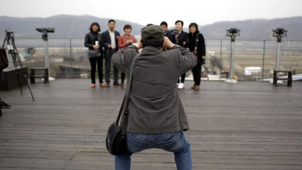Chinese tourists take pictures at the Imjingak Pavilion near the border village of Panmunjom, dividing the two Koreas.