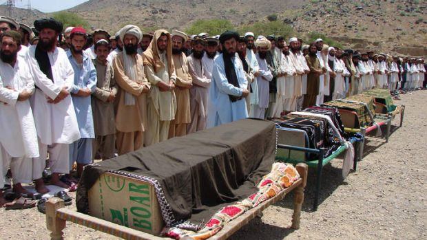 The price: Villagers mourn their dead after a drone attack in Miranshah, North Waziristan.