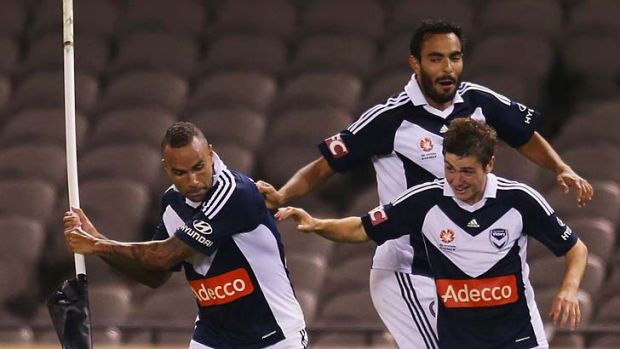 Archie Thompson celebrates after scoring the second goal for his team in extra-time against Perth Glory.