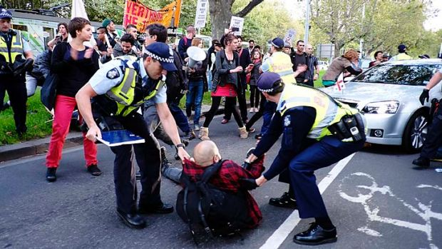 Protesters trying to stop Robert Doyle's car as it approaches the National Gallery of Victoria on Thursday.