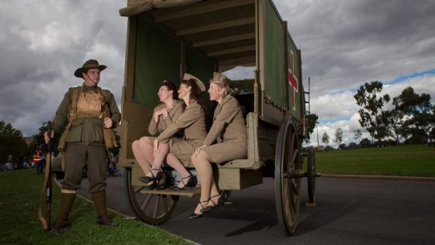 Phillip Hunting from the Australian Great War Association stands with the female vocal trio 'The Stilettos' (from left) ...