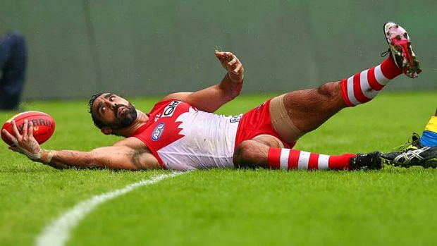 Eye on the ball: Adam Goodes controls the ball over the line in the Swans' victory over the Suns on Saturday at the SCG.