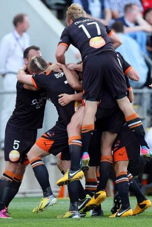 Onward and upward: Brisbane celebrate a goal on their way to securing a semi-final birth against Western Sydney ...