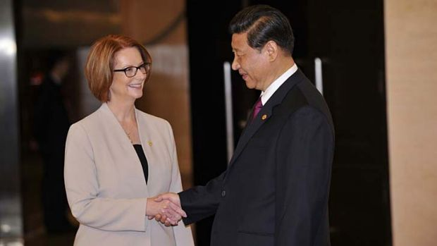 Addressing forum: Julia Gillard and Xi Jinping.