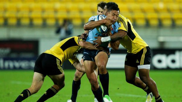 Bulldogs target: Waratah Israel Folau is tackled by the Hurricanes at Westpac Stadium.