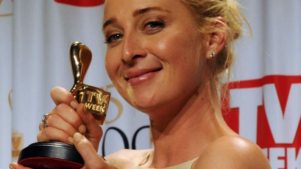 Smile for the cameras (but no audience) ... Asher Keddie wins the ultimate prize, the Gold Logie.