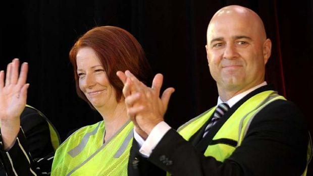 Prime Minister Julia Gillard and Mike Devereux at the launch of the new Holden Cruze at the Elizabeth car plant in ...