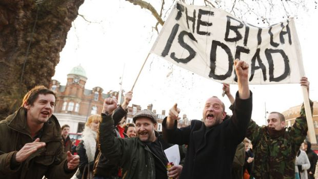 Revellers celebrate the death of Britain's former prime minister Margaret Thatcher at a party in Brixton, south London.