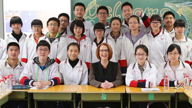 Prime Minister Julia Gillard with year 11 students at Chenjinglun High School in Beijing.