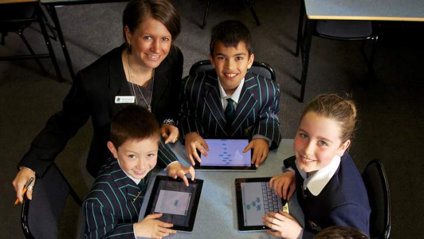 Pads out: Teacher Kate Hughes and her year 4 students at St Leonard's College, Brighton East. The school has embraced ...