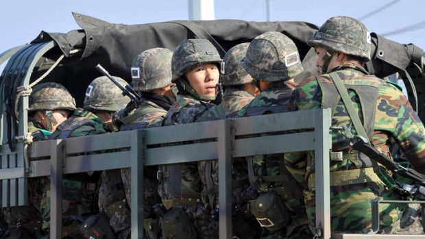 On the move: South Korean soldiers near the border city of Paju.