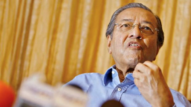 Still outspoken: Former prime minister Mahathir Mohamad talks to journalists at his residence on the outskirts of Kuala ...