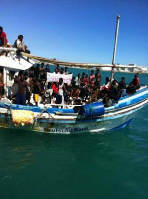 Long journey: Sri Lankan asylum seekers arriving at the port of Geraldton on Tuesday.