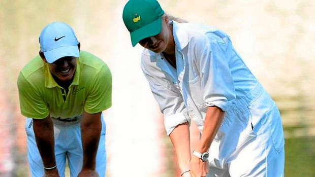 Putting for dough? Caroline Wozniacki with boyfriend Rory McIlroy.